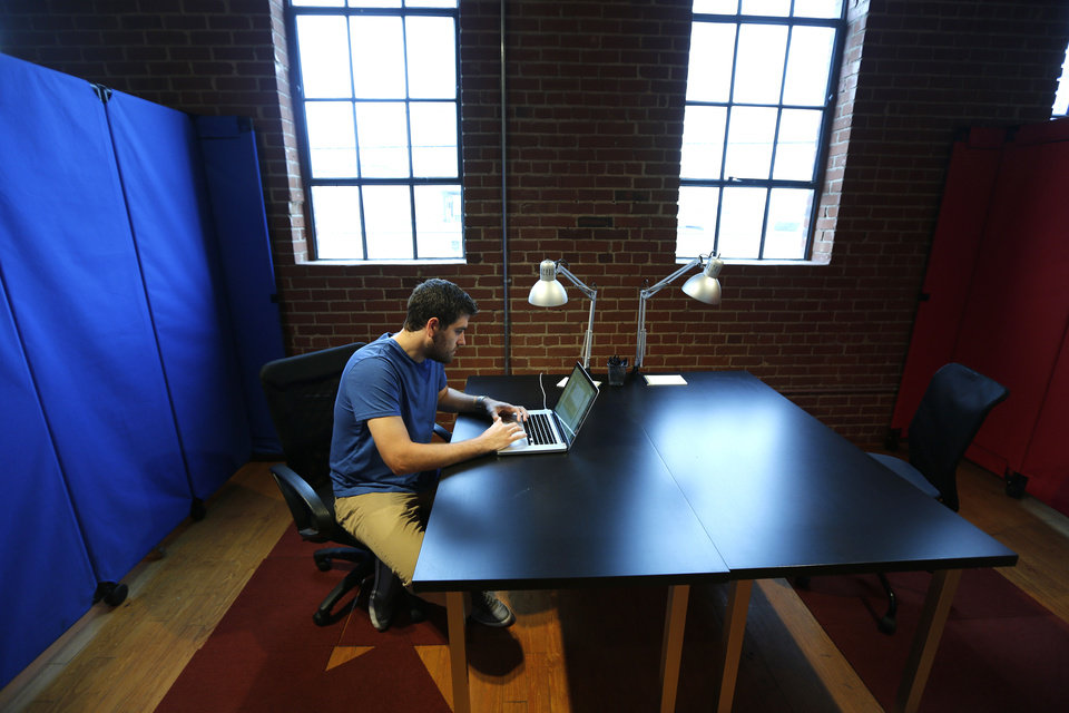 Hal Gatewood, creator of Zalongo works on his laptop at VENTURESPUR in Oklahoma City. PHOTO BY STEVE GOOCH, THE OKLAHOMAN <strong>Steve Gooch - The Oklahoman</strong>