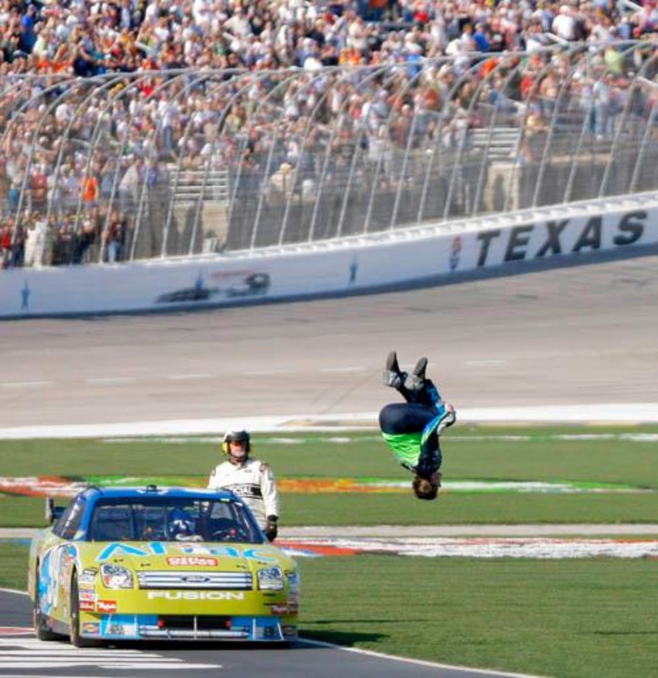 Photo -  Carl Edwards does a backflip to celebrate his win of the NASCAR Sprint Cup series Samsung 500 at Texas Motor Speedway in Fort Worth, Texas, Sunday, April 6, 2008. BY MATT STRASEN, THE OKLAHOMAN