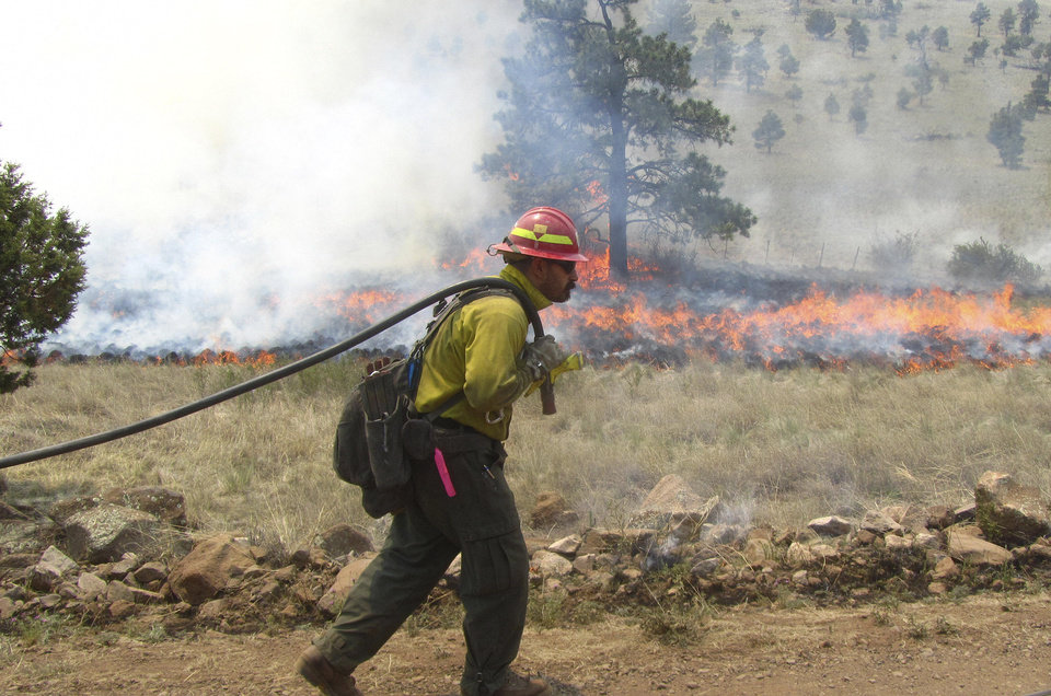 Photo -   A firefighter works an area along the northwest perimeter of a massive blaze in the Gila National Forest in New Mexico in this photo made on Wednesday, May 30, 2012, and released by the U.S. Forest Service Friday. More than 1,200 firefighters are battling the fire that has burned nearly 217,000 acres in an isolated mountainous area of southwestern New Mexico. (AP Photo/U.S. Forest Service, Alan Sinclair)