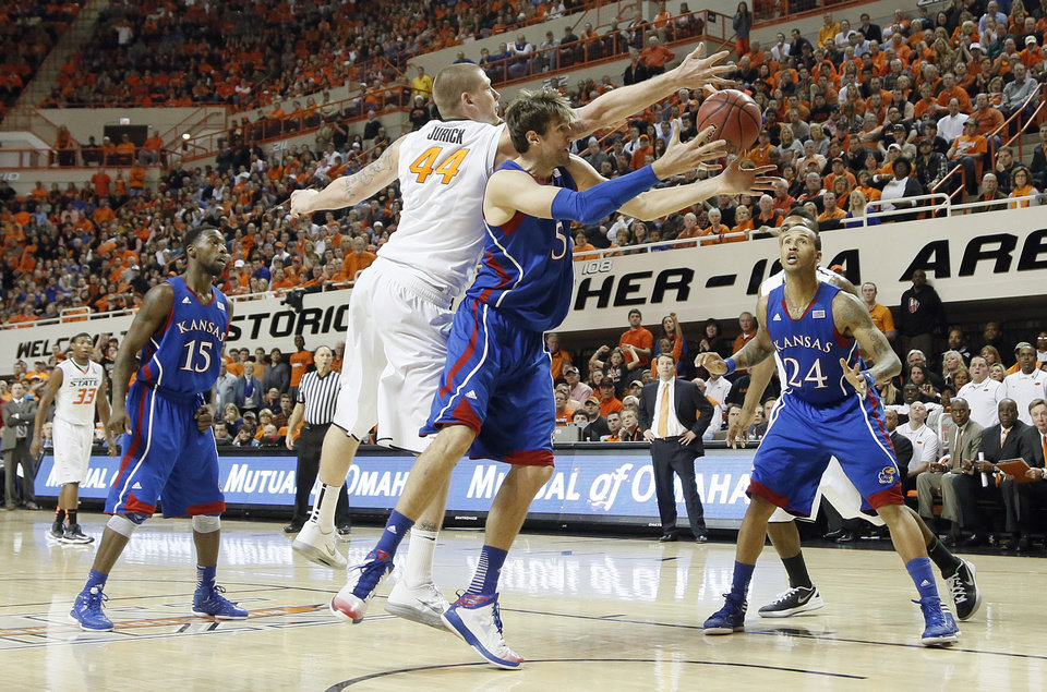 Photo - Oklahoma State 's Philip Jurick (44) and Kansas' Jeff Withey (5) fight for the loose ball during the college basketball game between the Oklahoma State University Cowboys (OSU) and the University of Kanas Jayhawks (KU) at Gallagher-Iba Arena on Wednesday, Feb. 20, 2013, in Stillwater, Okla. Photo by Chris Landsberger, The Oklahoman
