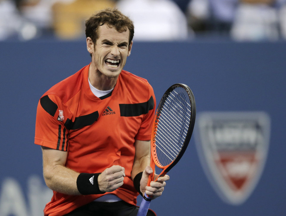 Photo - Andy Murray, of Britain, reacts after winning the third set against Denis Istomin, of Uzbekistan, during the fourth round of the U.S. Open tennis tournament, Tuesday, Sept. 3, 2013, in New York. (AP Photo/Charles Krupa)