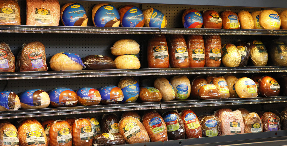 Photo - A collection of hams and turkeys at the new Uptown Grocery Co. in Edmond.  David McDaniel - The Oklahoman
