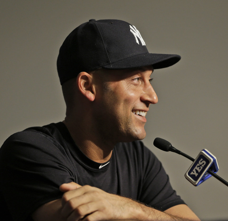 Photo - New York Yankees' Derek Jeter speaks during a news conference before Yankees baseball home opener against the Baltimore Orioles at Yankee Stadium, Monday, April 7, 2014 in New York. (AP Photo/Seth Wenig)