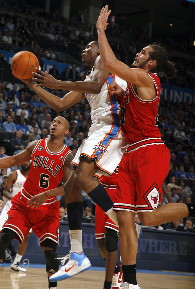 Photo - Oklahoma City's Kevin Durant goes for a lay up as Chicago's Joakim Noah defends during the NBA season opener basketball game between the Oklahoma City Thunder and the Chicago Bulls in the Oklahoma City Arena on Wednesday, Oct. 27, 2010. Photo by Sarah Phipps, The Oklahoman