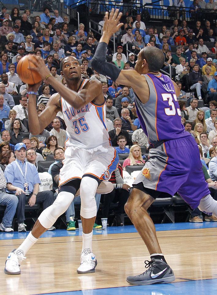 Oklahoma City Thunder small forward Kevin Durant (35) looks for a shot past Phoenix Suns small forward Grant Hill (33) during the NBA basketball game between the Oklahoma City Thunder and the Phoenix Suns at the Chesapeake Energy Arena on Wednesday, March 7, 2012 in Oklahoma City, Okla. Photo by Chris Landsberger, The Oklahoman