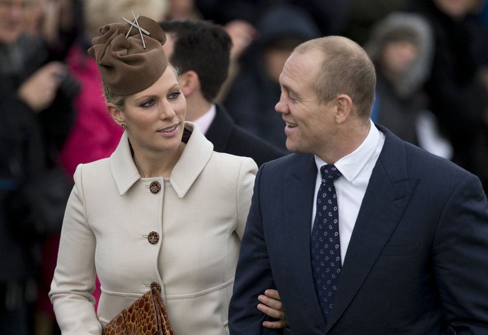 Photo - FILE -  Zara Phillips and her husband rugby player Mike Tindall in this file photo dated Tuesday, Dec. 25, 2012, as they arrive for a traditional Christmas Day church service in Sandringham, England. Buckingham Palace announced Friday Jan, 17, 2014, that  Queen Elizabeth II's granddaughter Zara Phillips and Mike Tindall have given birth to a 7 pounds, 12 ounces (3.5 kilograms) baby girl at Gloucestershire Royal Hospital. (AP Photo/Matt Dunham, FILE)