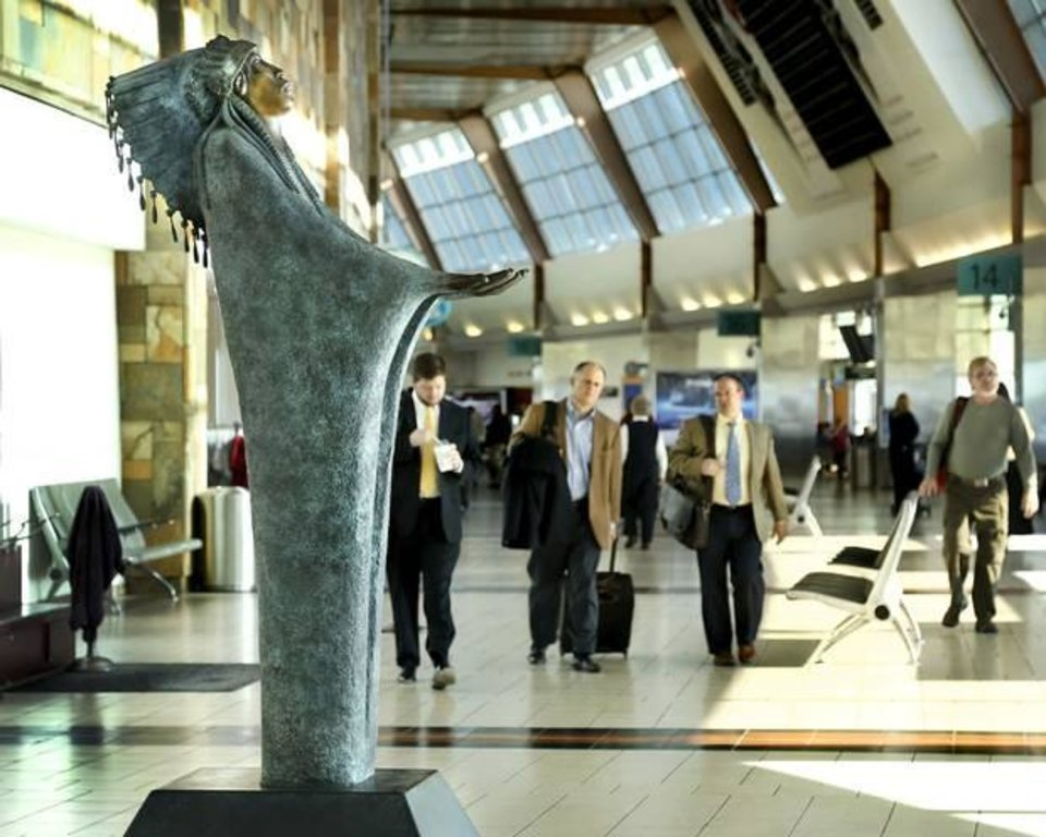 "Two bronze sculptures by Chiricahua Apache artist Allan Houser have been installed at Will Rogers World Airport in Oklahoma City. Standing eight feet tall and weighing nearly 1,000 pounds, the statue ""Prayer,"" right, is in the central concourse near the Coffee Bean & Tea Leaf. ""The Future"" statue is a bit smaller and is on the lower level by Baggage Claim 4.  Photo by Jim Beckel, The Oklahoman"