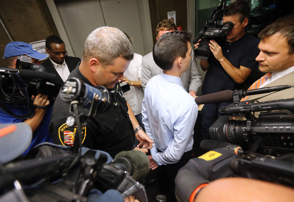 "After confessing on video to killing a man in a drunk-driving accident, Matthew Cordle, 22, center right, surrenders to sheriff's deputies at the Franklin County Corrections Center in Columbus, Ohio, Monday, Sept. 9, 2013. In a 3½-minute video posted last week, Cordle admitted he killed a suburban Columbus man and said he ""made a mistake"" when he decided to drive that night. (AP Photo/The Columbus Dispatch, Adam Cairns)"