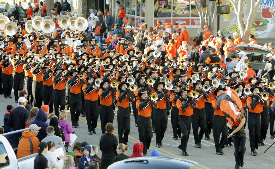 Photo - The OSU Marching Band participates in the Oklahoma State Cowboy's homecoming parade in downtown Stillwater, OK, Saturday, Oct. 29, 2011. By Paul Hellstern, The Oklahoman