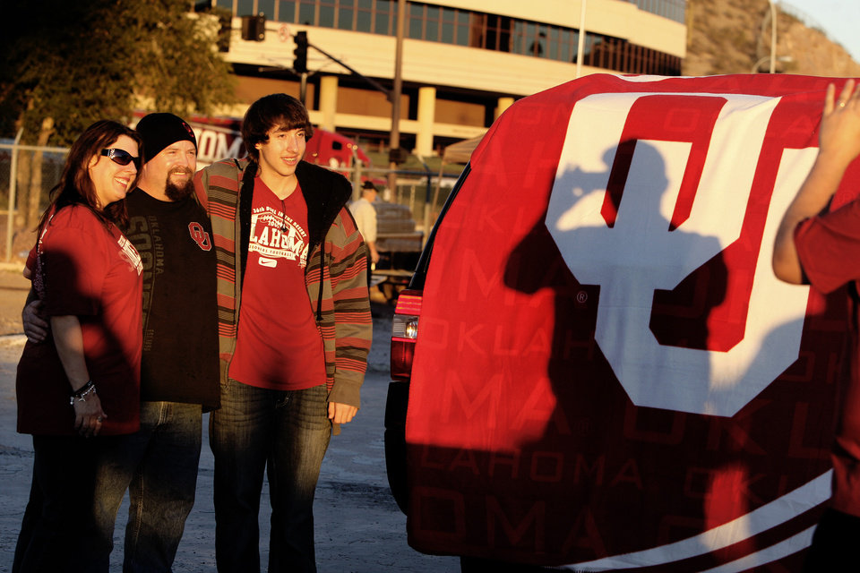 Mary and Beau Halsey, from Phoenix, pose with their son Bryan Osborne before the Insight Bowl college football game between the University of Oklahoma (OU) Sooners and the Iowa Hawkeyes at Sun Devil Stadium in Tempe, Ariz., Friday, Dec. 30, 2011. Photo by Bryan Terry, The Oklahoman