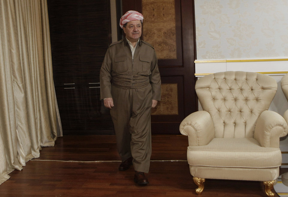 Photo -   Kurdish president Massoud Barzani walks before an interview with the Associated Press in Salah al-Din resort, Irbil north of Baghdad, Iraq, Wednesday, April 25, 2012. Barzani told The Associated Press on Wednesday that one possible alternative is a political revolt. He says opposition parties have run out of patience after feeling sidelined in al-Maliki's Shiite-led government. (AP Photo/Khalid Mohammed)