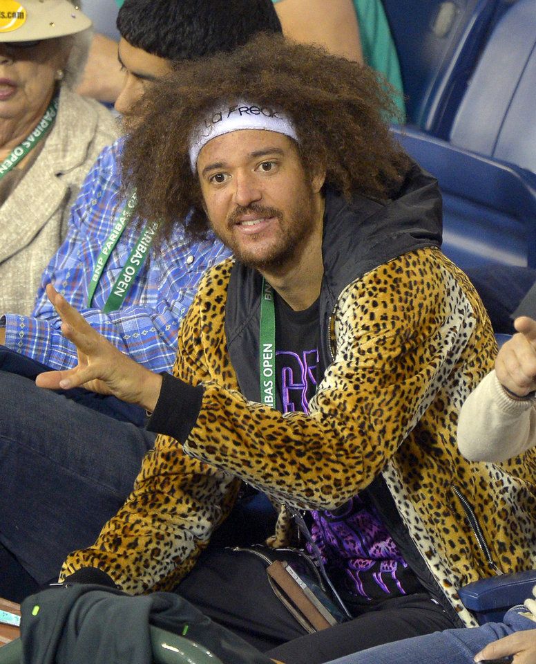 Photo - Musician Redfoo watches Victoria Azarenka, of Belarus, play Kirsten Flipkens, of Belgium, during their match at the BNP Paribas Open tennis tournament, Monday, March 11, 2013, in Indian Wells, Calif. (AP Photo/Mark J. Terrill)