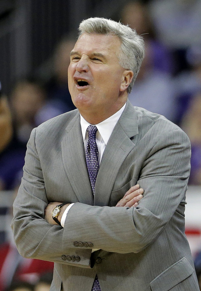 Kansas State coach Bruce Bruce Weber disputes a call during the first half of an NCAA college basketball game against Florida, Saturday, Dec. 22, 2012, at the Sprint Center in Kansas City, Mo. (AP Photo/Charlie Riedel)