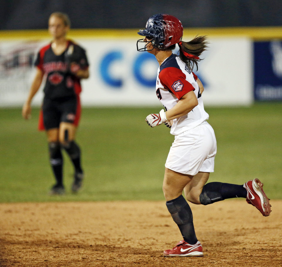 Lauren Gibson (27) of the United States runs the bases after hitting a two-run home run in the sixth inning during a game between Team USA and Canada in the World Cup of Softball at ASA Hall of Fame Stadium in Oklahoma City, Thursday, July 11, 2013. Team USA won 7-0 in 6 innings. Photo by Nate Billings, The Oklahoman