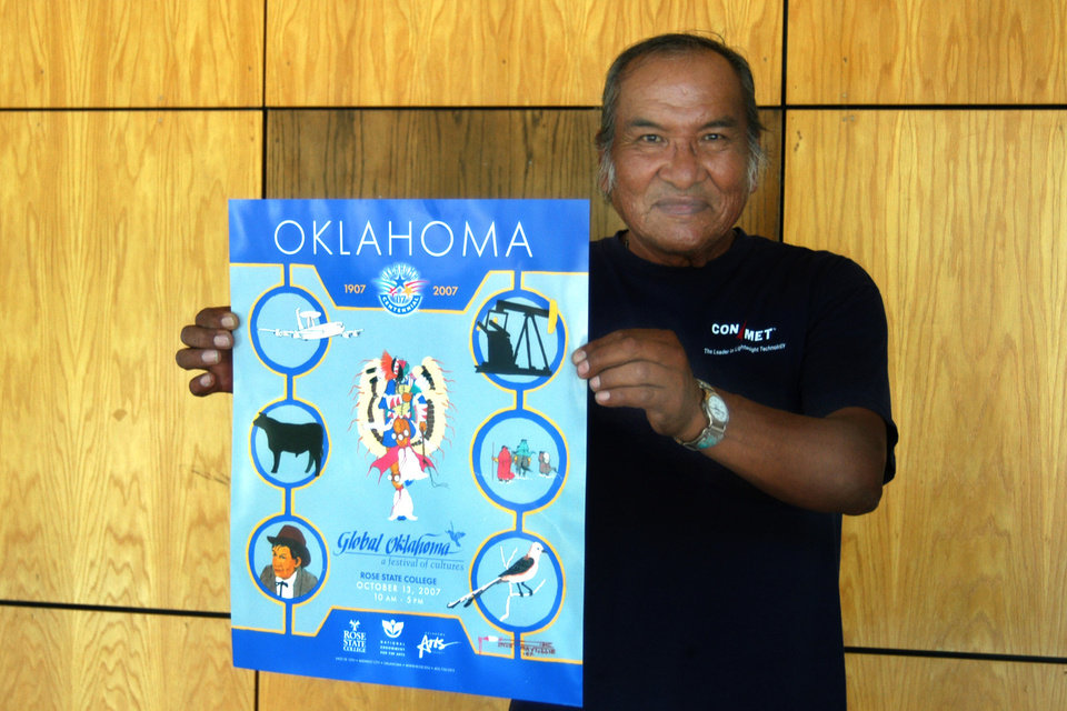 Doug Maytubbie, Native American artist, holds up the 2007 Global Oklahoma poster he designed and painted.<br/><b>Community Photo By:</b> Steve Reeves<br/><b>Submitted By:</b> Donna, Choctaw