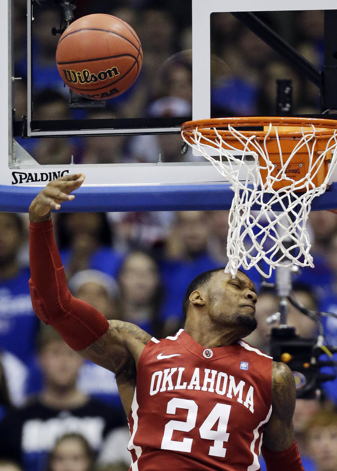 Photo - Oklahoma forward Romero Osby (24) misses a dunk during the first half of an NCAA college basketball game against Kansas in Lawrence, Kan., Saturday, Jan. 26, 2013. (AP Photo/Orlin Wagner) ORG XMIT: KSOW102