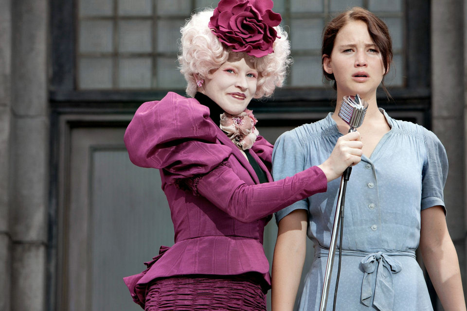 "Effie Trinket (Elizabeth Banks, left) and Katniss Everdeen (Jennifer Lawrence) in ""The Hunger Games."" PHOTO BY MURRAY CLOSE PROVIDED. <strong>Photo credit: Murray Close</strong>"