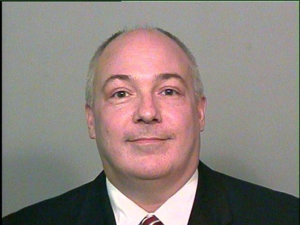 State Rep. Randy Terrill smiles for this jail photo taken today when he turned himself in at the Oklahoma County jail.