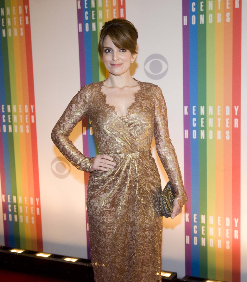 Photo - Actress Tina Fey arrives at the Kennedy Center for the Performing Arts for the 2012 Kennedy Center Honors Performance and Gala Sunday, Dec. 2, 2012 at the State Department in Washington. (AP Photo/Kevin Wolf)