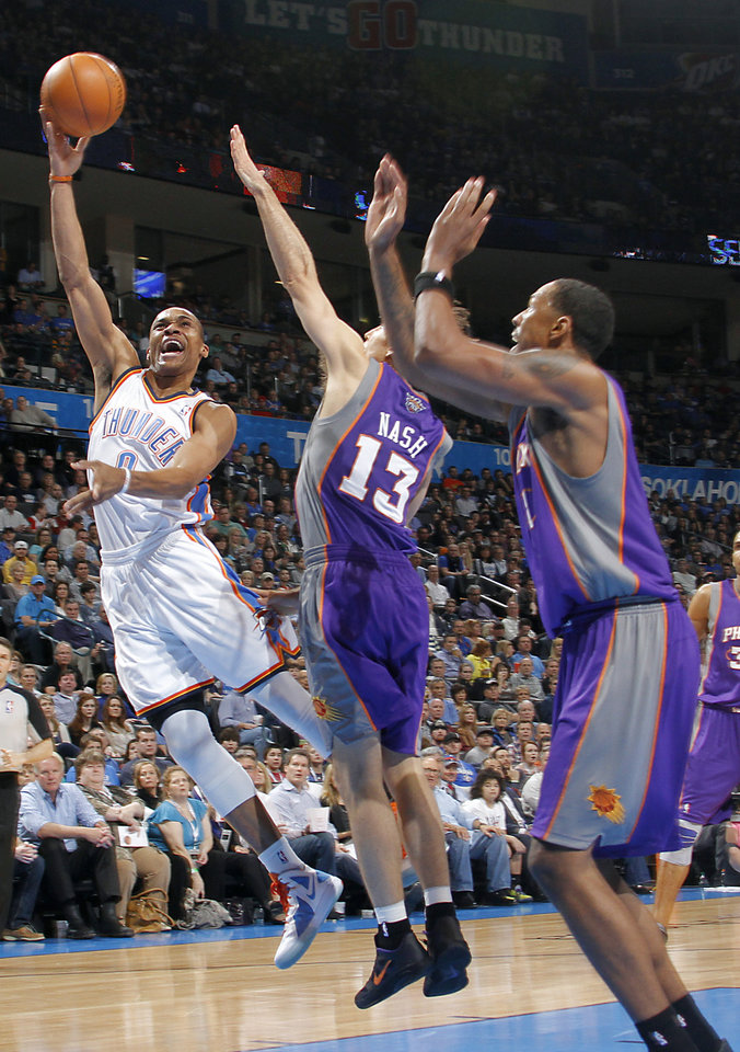 Oklahoma City Thunder point guard Russell Westbrook (0) shoots the ball over Phoenix Suns point guard Steve Nash (13) during the NBA basketball game between the Oklahoma City Thunder and the Phoenix Suns at the Chesapeake Energy Arena on Wednesday, March 7, 2012 in Oklahoma City, Okla.  Photo by Chris Landsberger, The Oklahoman