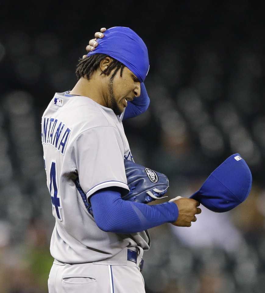 Photo - Kansas City Royals starting pitcher Ervin Santana pauses after giving up a hit to the Seattle Mariners in the second inning of a baseball game Wednesday, Sept. 25, 2013, in Seattle. (AP Photo/Elaine Thompson)