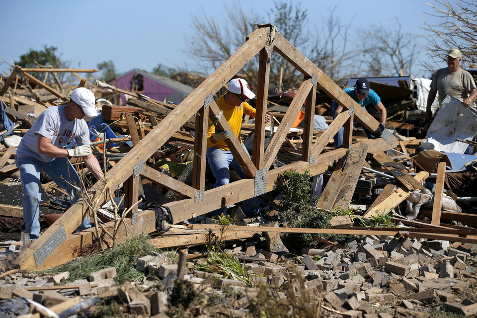 Photo - People sort the remains of a home near Plaza Tower Elementary in Moore, Okla., on Wednesday, May 22, 2013. The area was heavily damaged by a  tornado that struck on Monday, May 20, 2013. Photo by Bryan Terry, The Oklahoman