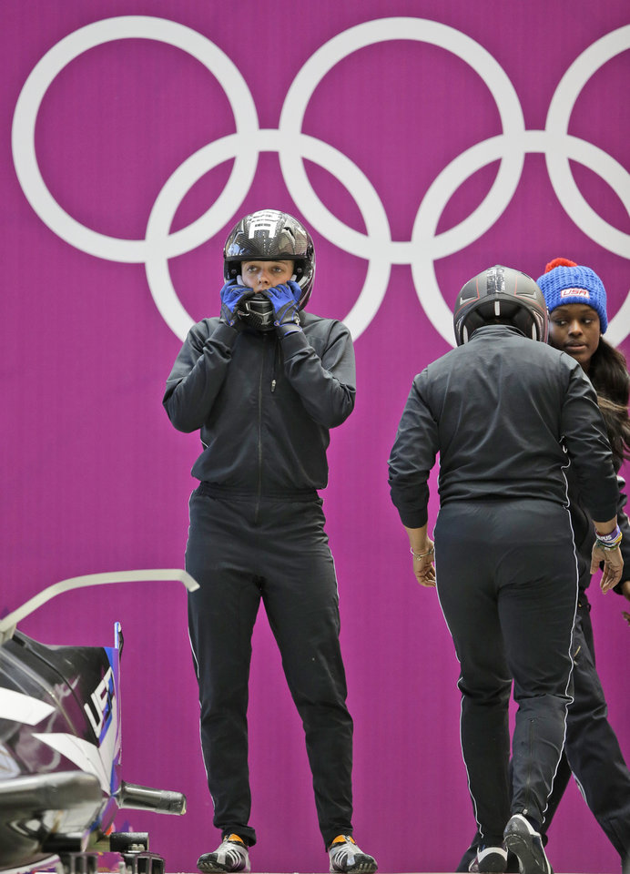 Photo - Lolo Jones of the United States prepares to start a training run for the women's bobsleigh at the 2014 Winter Olympics, Saturday, Feb. 15, 2014, in Krasnaya Polyana, Russia. (AP Photo/Dita Alangkara)