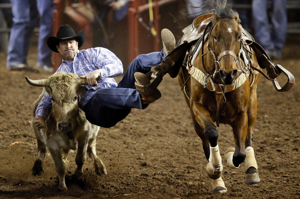 Photo - Walt Sherry of Atwook, Okla., competes in steer wrestling during the International Finals Rodeo (IFR 44) at the Jim Norick Arena at State Fair Park in Oklahoma City, Sunday, Jan. 19, 2014. Photo by Nate Billings, The Oklahoman