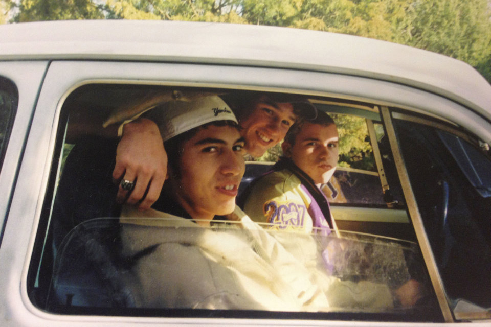 Photo - From left, Billy Long, Tyler Ford and a friend are pictured the day Long wrecked his car on Interstate 40. Ford died, and Long was seriously injured. Photo provided