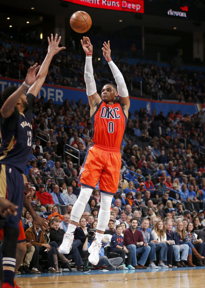 Photo - Oklahoma City's Russell Westbrook (0) shoots during the NBA game between the Oklahoma City Thunder and the New Orleans Pelicans at the Chesapeake Energy Arena,  Sunday, Dec. 4, 2016. Photo by Sarah Phipps, The Oklahoman