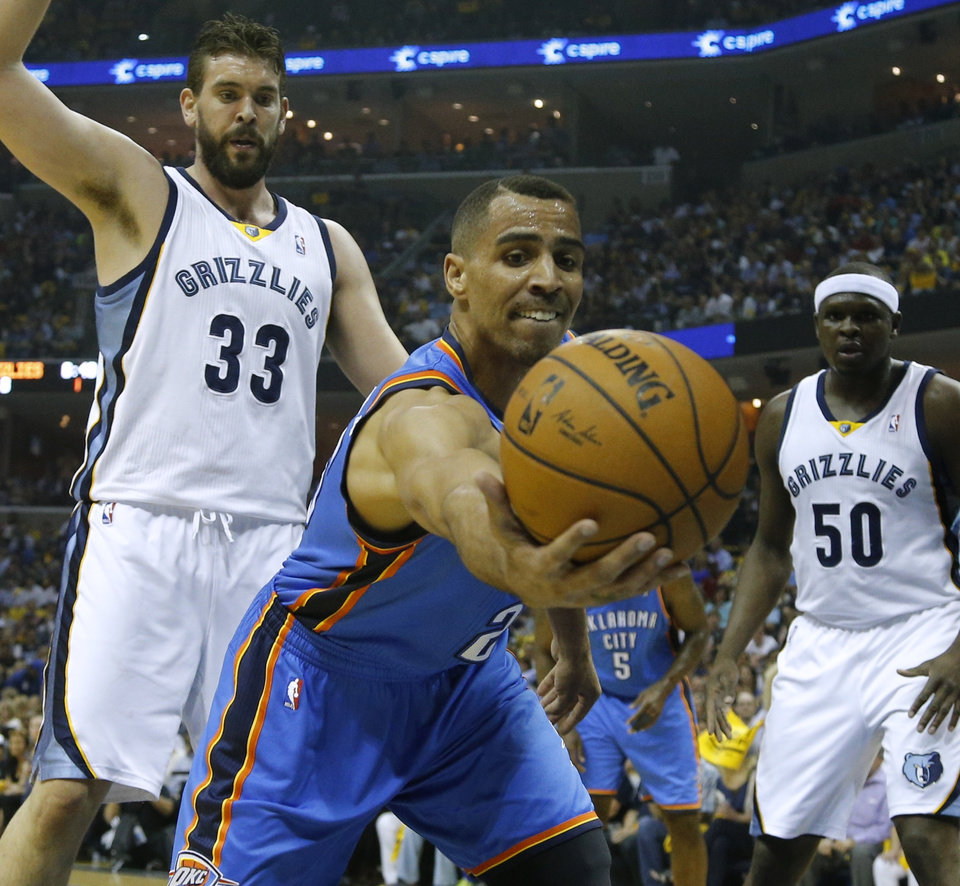 Oklahoma City's Thabo Sefolosha reaches for the ball during Game 4 in the first round of the NBA playoffs between the Oklahoma City Thunder and the Memphis Grizzlies at FedExForum in Memphis, Tenn., Saturday, April 26, 2014. PHOTO BY BRYAN TERRY, The Oklahoman