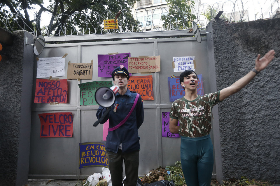 Gay rights supporters perform outside the Russia consulate during a protest in Rio de Janeiro, Sunday, Sept. 8, 2013. About a hundred gay rights supporters carried placards and chanted slogans outside the Russian consulate to protest Moscow's policies on homosexuality. (AP Photo/Silvia Izquierdo)