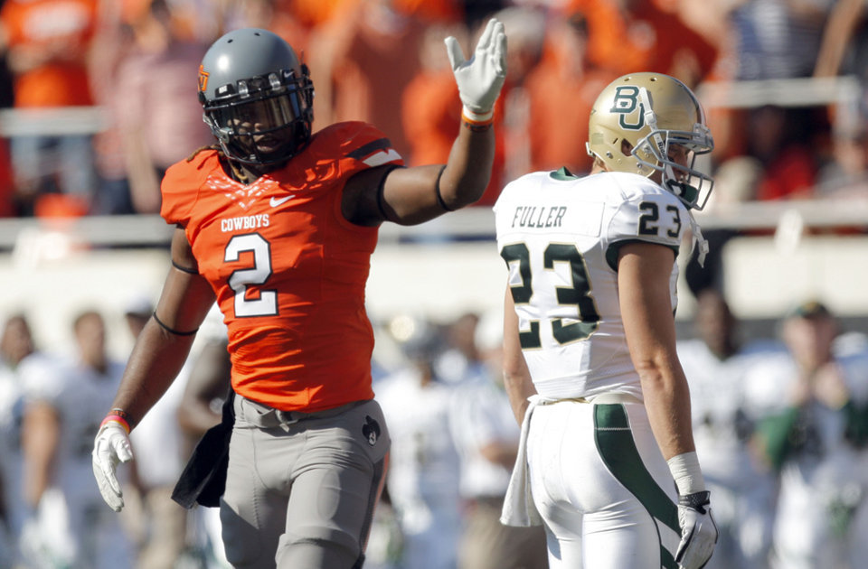 Photo - Oklahoma State's Lavocheya Cooper (2)celebrates a fumble recovery on a kick off in front of Baylor's Clay Fuller  during a college football game between the Oklahoma State University Cowboys (OSU) and the Baylor University Bears (BU) at Boone Pickens Stadium in Stillwater, Okla., Saturday, Oct. 29, 2011. Photo by Sarah Phipps, The Oklahoman