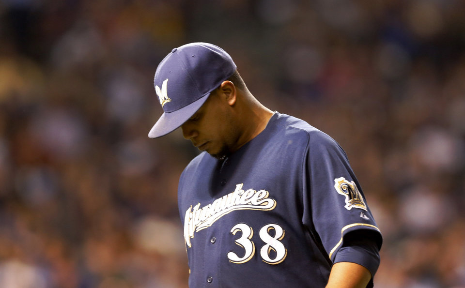 Photo - Milwaukee Brewers starting pitcher Wily Peralta leaves the game during the seventh inning of a baseball game against the Chicago Cubs Tuesday, Aug. 12, 2014, in Chicago. (AP Photo/Charles Rex Arbogast)