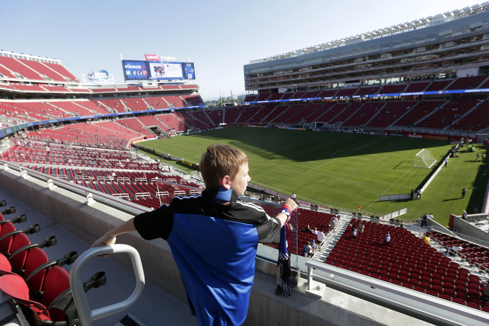 Photo - Westin McCall, of Danville, Calif., takes in a view of the new Levi's Stadium before an MLS soccer match between the San Jose Earthquakes and the Seattle Sounders on Saturday, Aug. 2, 2014, in Santa Clara, Calif. (AP Photo/Marcio Jose Sanchez)