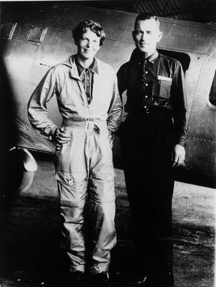 Photo - FILE - In this May 1937 file photo, American aviaor Amelia Earhart and her navigator, Fred Noonan, pose in front of their twin-engine Lockheed Electra in Los Angeles prior to their flight around the world.  Earhart's disappearance in 1937 is among aviation's most enduring mysteries. Earhart, the first female pilot to cross the Atlantic Ocean, vanished over the Pacific with Noonan during an attempt to circumnavigate the globe. Seven decades later, people are still transfixed with the mystery. Theories range from her simply running out of fuel and crashing to her staging her own disappearance and secretly returning to the U.S. to live under another identity. (AP Photo/File)