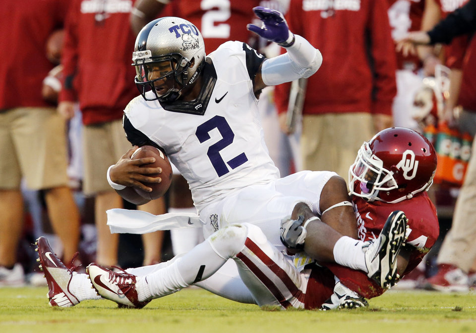 Photo - Oklahoma's Aaron Colvin (14) sacks TCU's Trevone Boykin (2) during a college football game between the University of Oklahoma Sooners (OU) and the TCU Horned Frogs at Gaylord Family-Oklahoma Memorial Stadium in Norman, Okla., on Saturday, Oct. 5, 2013. Photo by Steve Sisney, The Oklahoman