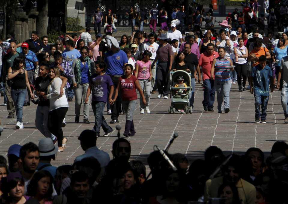 Photo -   People enter the Chapultepec Park in Mexico City, Sunday, Nov. 18, 2012. Chapultepec is a park divided between shady stretches of forest and more-developed plazas, fountains and sculpture gardens. On weekends, the northern end is crammed with vendors, entertainers and families out for the day. (AP Photo/Marco Ugarte)