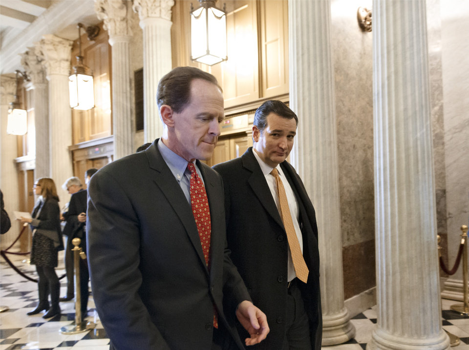 Photo - Sen. Pat Toomey, R-Pa., left, and Sen. Ted Cruz, R-Texas, right, arrive at the Senate on Capitol Hill in Washington, Tuesday, Jan. 7, 2014, for a procedural vote on legislation to renew jobless benefits for the long-term unemployed. The vote was 60-37 to limit debate on the legislation, with a half-dozen Republicans siding with the Democrats on the test vote. (AP Photo/J. Scott Applewhite)