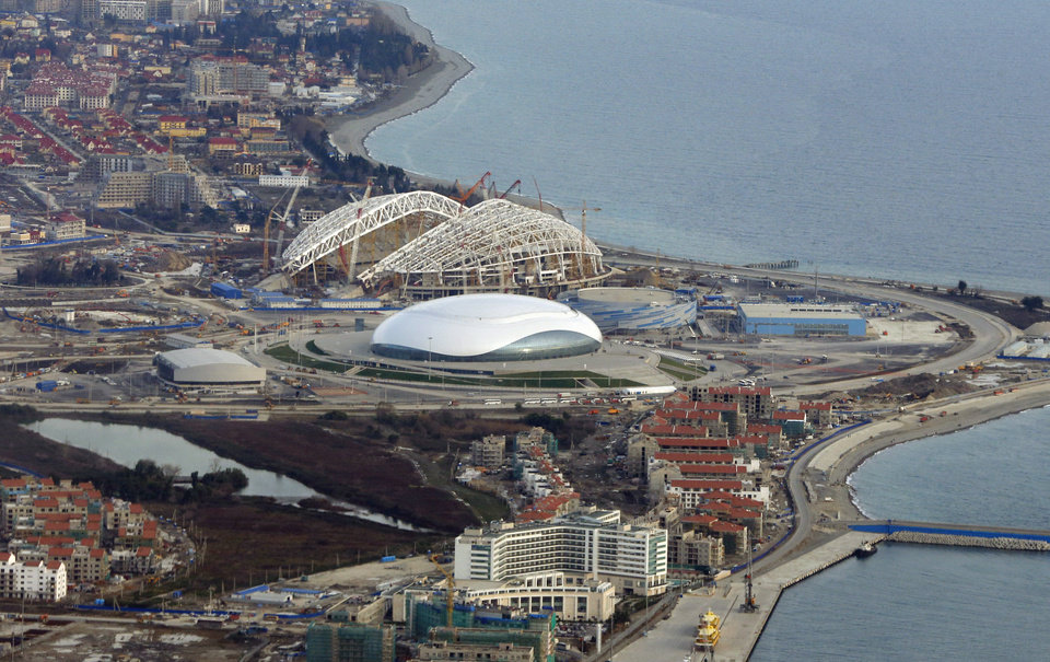 Photo - FOR STORY RUSSIA SOCHI YEAR TO GO -  In this photo dated Monday, Feb. 4, 2013, an aerial view of the Olympic Park as construction works continue in the lead up to the upcoming winter games in Sochi, Russia. With just one year till the opening ceremony of the winter Olympic 2014 Sochi Games, the Black Sea resort of Sochi is a vast construction site sprawling for nearly 40 kilometers (25 miles) along the coast and 50 kilometers (30 miles) up into the mountains, with no escape from the clang and clatter of the construction works, the drilling, jack-hammering and mixing of cement. (AP Photo/Dmitry Lovetsky)