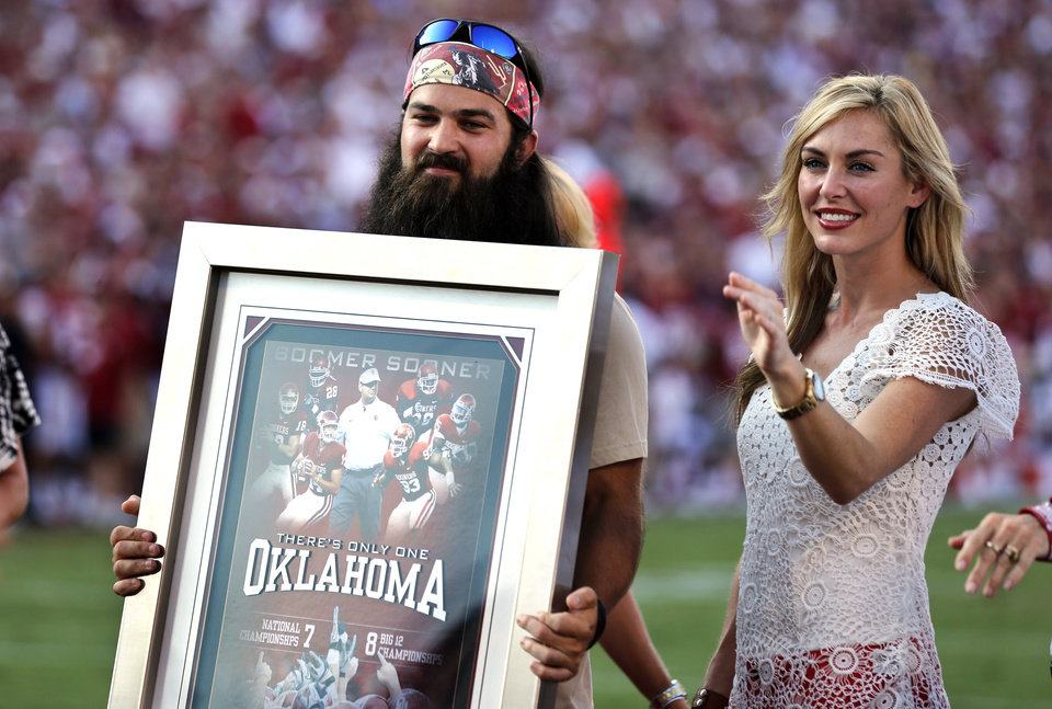 Duck Dynasty family members Jep and Jessica Robertson participate in activities during the first half of the college football game where the University of Oklahoma Sooners (OU) play the University of Louisiana Monroe Warhawks at Gaylord Family-Oklahoma Memorial Stadium in Norman, Okla., on Saturday, Aug. 31, 2013. Photo by Steve Sisney, The Oklahoman