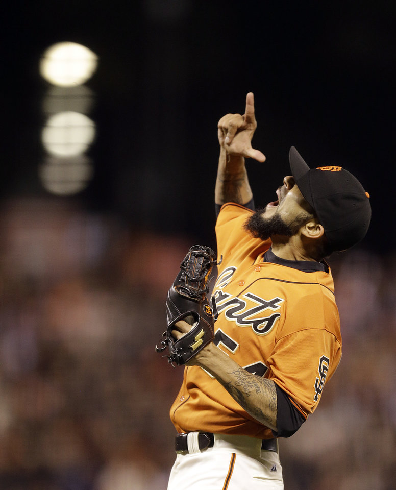 Photo - San Francisco Giants' Sergio Romo celebrates as the final out is made against the New York Mets at the end of a baseball game Friday, June 6, 2014, in San Francisco. (AP Photo/Ben Margot)