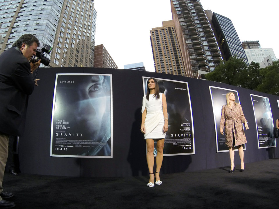 "Actress Sandra Bullock arrives at the premiere of ""Gravity"" at the AMC Lincoln Square Theaters on Tuesday, Oct. 1, 2013, in New York. (Photo by Evan Agostini/Invision/AP) ORG XMIT: NYEA136"