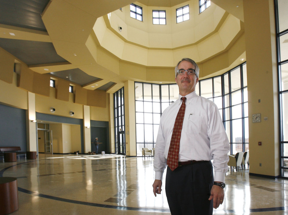 Photo - UCO / ENTRANCE: Dr. Dwight Adams demonstrates the atrium entry at the new Forensic Science Institute on the campus of the University of Central Oklahoma in Edmond, OK, Tuesday, Dec. 1, 2009. By Paul Hellstern, The Oklahoman ORG XMIT: KOD