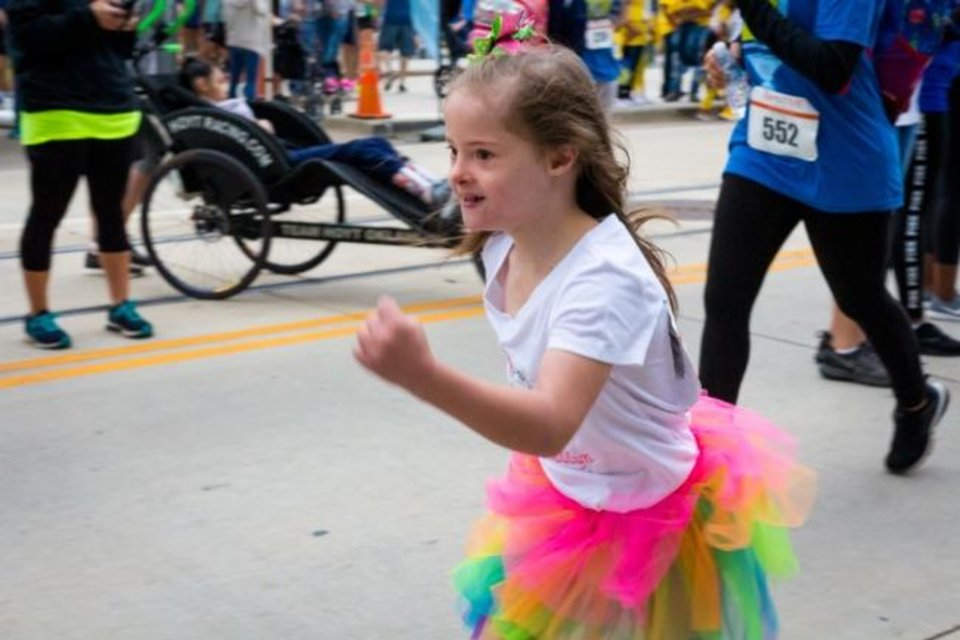 Photo -  Maddyn Brakage sprints toward the finish line at the 2019 Down Syndrome Festival and 5K. [PHOTO PROVIDED]