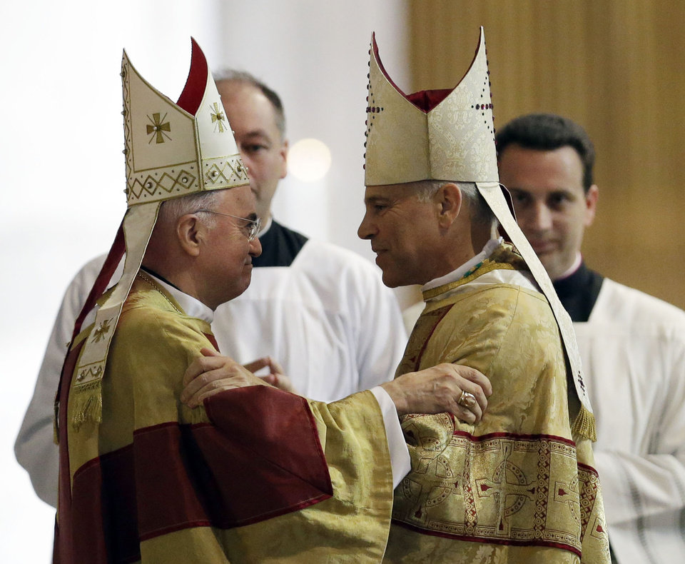 Photo -   Salvatore J. Cordileone, right, is embraced by Archbishop Carlo Maria Vigano, Vatican Ambassador to the U.S. during a ceremony to install Cordileone as the new archbishop of San Francisco at the Cathedral of St. Mary of the Assumption in San Francisco, Thursday, Oct. 4, 2012. (AP Photo/Marcio Jose Sanchez, Pool)