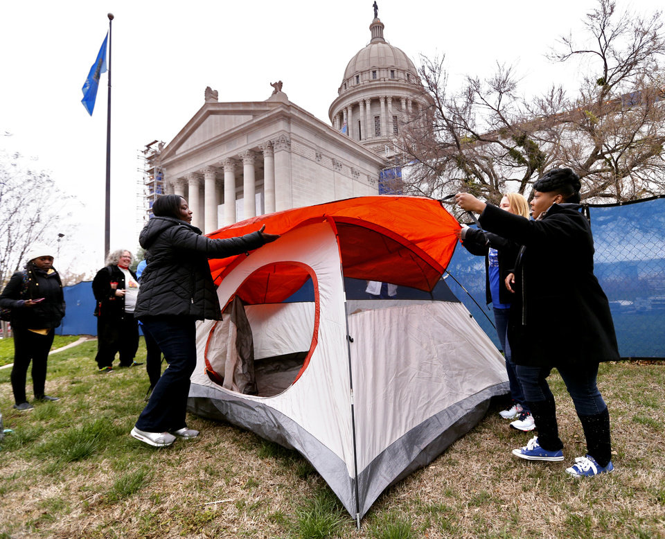Photo - Teachers from Green Pastures Elementary School set up a tent as Oklahoma teachers hold a rally at the State Capitol on Monday, April 2, 2018 in Oklahoma City, Okla.  Photo by Steve Sisney, The Oklahoman