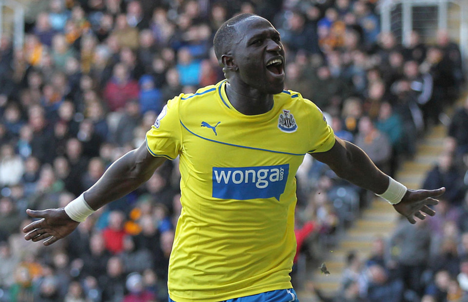 Photo - Newcastle United's Moussa Sissoko, celebrates scoring  his second goal of the game against Hull during the English Premier League match at the KC Stadium, Hull England Saturday March 1, 2014. (AP Photo/Lynne Cameron/PA)  UNITED KINGDOM OUT