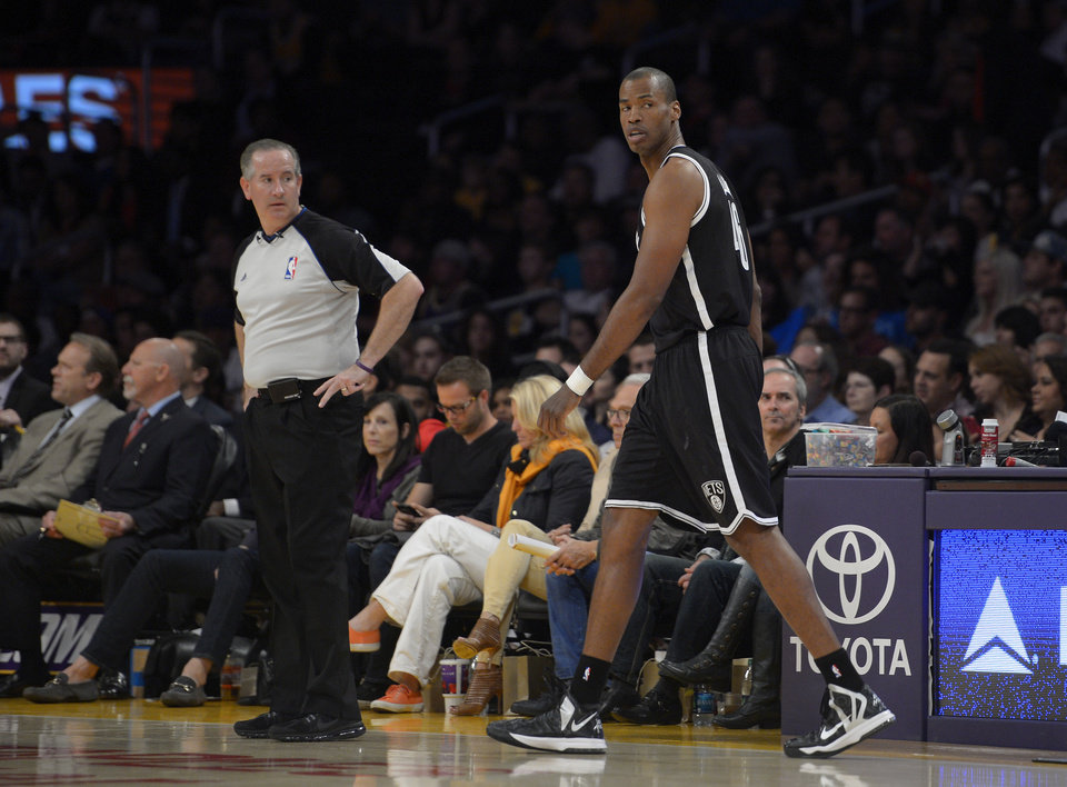 Photo - Brooklyn Nets center Jason Collins comes into the game for the first time during the first half of an NBA basketball against the Los Angeles Lakers, Sunday, Feb. 23, 2014, in Los Angeles. (AP Photo/Mark J. Terrill)