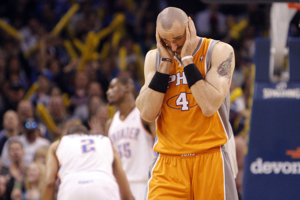 Phoenix's Marcin Gortat (4) reacts after Phoenix's Vince Carter (25) missed 2 free throws during the NBA game between the Oklahoma City Thunder and the Phoenix Suns, Sunday, March 6, 2011, the Oklahoma City Arena. Photo by Sarah Phipps, The Oklahoman.